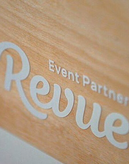Logotype Revue on sign wood